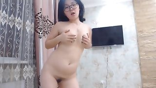 Cute Asian Nerdy Teen Dancing In one's birthday suit