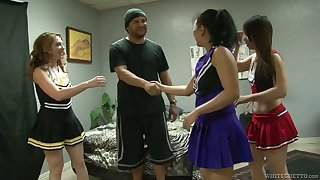 Poor dude is fucked by Kiki Daire and cheerleaders wearing strapons