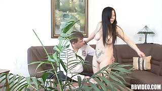 Tattooed brunette get it doggystyle on the couch in her living room