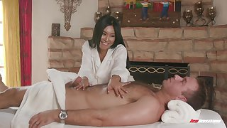 Asian MILF babe Honey Moon massages a cock with her shaved pussy