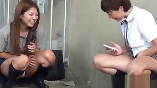 Two girls get adulterated pissing increased by filming perpetually other outside