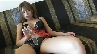 Asami Kubota, a leather outfit and a clear dildo
