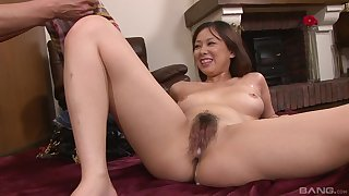 Asian dreamboat soaks her hairy cunt in warm sperm