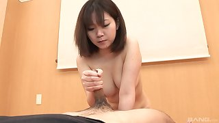 Busty Japanese girl treats herself with a tasty dick
