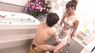 Along to naughty Japanese wife enjoys a soapy adventure in the tub